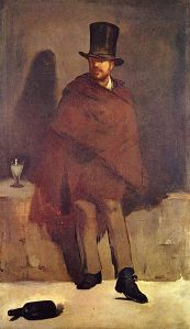 man in a ragged cloak and large hat