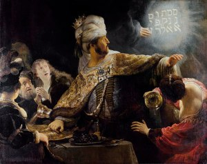 Belshazzar sees the writing on the wall.